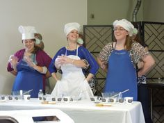 Helping Hands:  Kitchen Edition  This was a game played at a kitchen themed bridal shower.  The ladies in the front could not use their hands to mix-up some icing to ice a sugar cookies.  The last task was to take a bite of the finished iced cookie.