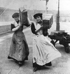 Two women replace the traditionally male porters at Marylebone Station in London during the First World war. Illustrated London News, 1915.