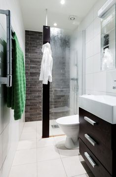 Like the idea of the glass door coming out half way. Good colors too for making a small bathroom look larger.