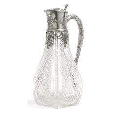 A FABERGÉ SILVER-MOUNTED CUT GLASS DECANTER, MOSCOW, 1899-1908 baluster form, the collar cast with wavy leaves, the handle formed as a branch, struck K.Fabergé in Cyrillic beneath the Imperial Warrant, 84 standard, scratched inventory number 12546