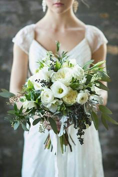 Gorgeous Hand Tied Wedding Bouquet Comprised Of: White Lisianthus + Buds, White English Garden Roses, White Ranunculus, White Stock, Dark Blue Privet Berries, Dusty Miller, Green Seeded Eucalyptus + Additional Greenery/Foliage ••••