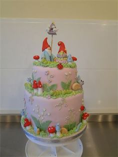 Gnome and Toadstool wedding cake. : Cake with Gnomes wedding topper and fantasy fairy land decorations.