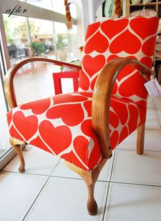 "Reupholstered chair by Flourish and Blume. The fabric is ""Grand Hearts"" in Kimono Red and is designed by Umbrella Prints"