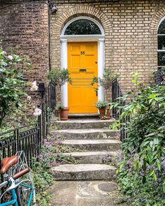 A Lady in London on Instagram: This yellow front door on a brick house in London is stunning. Located in Camberwell, London, this door and its front steps give great facade design ideas. Camberwell London, Secret Places In London, Camberwell College Of Arts, Front Steps, Facade Design, London Travel, Brick, Design Ideas