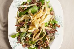 Bacon, pear and blue cheese salad with honeyeed walnuts and parsnip crisps  A tasty seasonal salad, with a wonderful combination of crunchy nuts, sweet honeyeed parsnips, and salty bacon and blue cheese.   An impressive side at festive parties. http://www.riverford.co.uk/recipes/view/recipe/bacon-pear-bluecheese-with-walnuts
