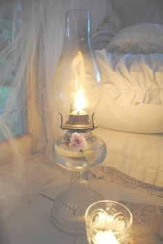 Oil lamp and candles oh so shabby chic.