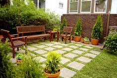 The use of the paving with the grass is an effective way to make the courtyard look bigger - and the colours look great! You could add a checkerboard (and even oversized chess pieces!) to create a fun games space!