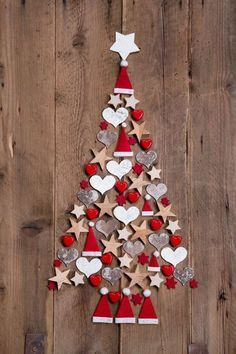Photo about New design for a christmas tree - red and white decoration for xmas on a wooden brown background. Image of greetings, noel, colored - 34585448 Diy Christmas Tree, Christmas Door, Xmas Tree, Christmas Projects, Christmas Holidays, Christmas Ornaments, Ornaments Ideas, Felt Ornaments, Christmas Ideas