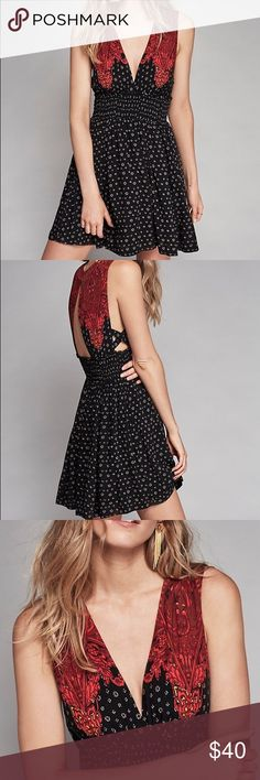 Free people dress Black combo walking through my dreams. Printed mini dress featuring a swingy skirt and smoked elastic waistband for an easy fit. Plunging V-neckline in front and opening in back. Crisscross side straps. Lined.  100% Rayon Machine Wash Cold Free People Dresses