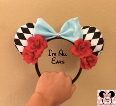 These HANDMADE Alice in Wonderland Inspired Mouse ears are perfect for your magical trip to theme parks, conventions, and more! Made to fit and be worn by all ages. Price; 30.20