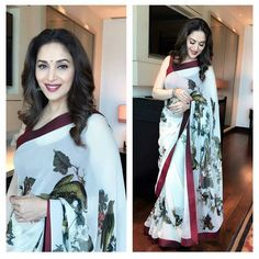 Madhuri Dixit in black and white  leaf sari with red border.