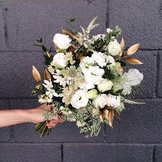 A pre-wedding shoot bouquet in white and gold.