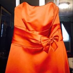 Formal dress/ bridesmaid dress This is an absolute beauty. The dress is a orange/red color and was worn once for literal an hour by my daughter. This dress is in like new conditions. No stains, rips or smells. Alfred Angelo Dresses Strapless