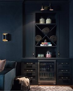 A black built-in basement bar features a glass front beverage fridge flanked by black cabinets donning black and gold pulls. Home Cinema Room, Home Theater Rooms, Green Cabinets, Built In Cabinets, Basement Movie Room, Basement Gym, Basement Remodeling, Bathroom Remodeling, Wet Bar Designs