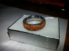 I really can't resist putting up another picture of my wedding ring.  I was married on April 5th 2014, and I made my own wedding ring.  I used a titanium band for the structure of the ring, and epoxied a piece of Briar over it.  The Briar was then contras