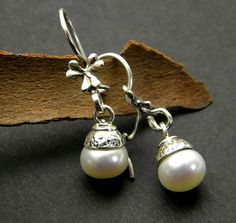 Small dangle pearl earrings in sterling silver by nikiforosnelly