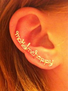 """""""These distinct pieces from the Karmadia collection are fun pieces that have popular sayings on them. They are also customizable, so you can have any saying made into a wearable piece. Each of these earrings are made out of hand-bent copper wire and are clipped onto the ear, so no piercings are required"""""""