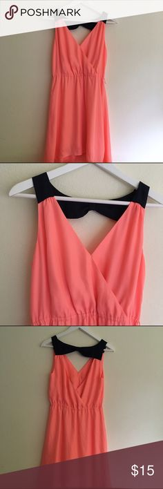 AMERICAN EAGLE Dress Sleeveless  V-neck  Cut out back with bow  Elastic waist  Lined  Coral and navy blue  100% Polyester  Size Small   Condition: no stains tear or wear.  ☑️No Pets  ☑️Non-Smoking home  ☑️Every item steamed throughly before shipped!  💌 Ships from Santa Monica, CA  🗝Follow me on Instagram! @koukil1908 ask to have a video of the item ✌️ American Eagle Outfitters Dresses High Low