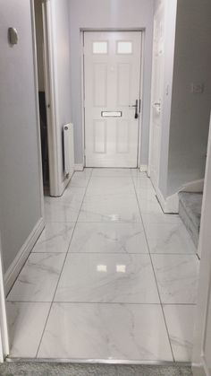 Hallway with polished marble tiles and Dulux 'Polished Pebble' paint Grey Hallway, Tiled Hallway, Hallway Flooring, Living Room Flooring, Grey Marble Tile, Marble Floor, Tile Floor, Dulux Polished Pebble, Inside Design