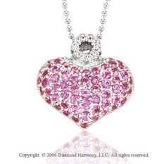 14k White Gold Pink Sapphire Pave Diamond Heart Necklace -> Description: A full heart of white gold with a circular crown of nine round prong set diamonds is speckled with 62 pink sapphires. You 'll feel thoroughly ebullient wearing this 14k W Gold Pink Sapphire Pave Diamond Heart Necklace. -> sku=HT9171 -> Price $685.00