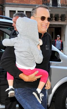 Grandpa Tom Hanks, in sleek square aviators, was all smiles as he spent some quality time with his grandson in London! How cute?!