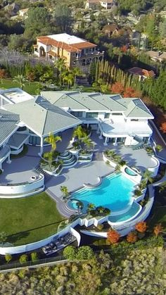 Looking for a luxurious home in the hills? I love the way this home design works for its outdoor area.Eddie Murphy's 40,000 square foot Beverly Hills Mansion!