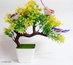 Checkout this latest Plants_1000-1500 Product Name: *Classy Decorative Artificial Bonsai Plants* Material: Synthetic & Plastic Size (H ): 25 cm  Description: It Has 1 Piece Of Artificial Plants with Hanging Birds Guest Greeting Pine Bonsai Country of Origin: India Easy Returns Available In Case Of Any Issue   Catalog Rating: ★4 (2589)  Catalog Name: Classy Decorative Artificial Bonsai Plants Vol 3 CatalogID_704474 C127-SC1610 Code: 062-4829326-285