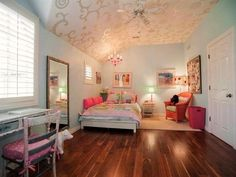 The little girl of the family has a suite all to herself in a room fit for a princess. The beautiful hardwood floors and specific areas to study, play and sleep are all highlighted by a whimsical [more] chandelier and fairy tale decor.