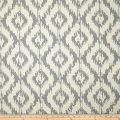 Eroica Tribal Coral from @fabricdotcom  Refresh and modernize any piece of furniture with this heavyweight jacquard fabric, perfect for window treatments, accent pillows, upholstering furniture, headboards and ottomans. Colors include off white and silver.