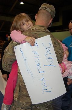 "A great ""Welcome Home Hug"" photo from @USArmy: A Soldier from the 111th Quartermaster Company at Fort Lee, Va., hugs his daughter Jan. 18, 2013, during a redeployment ceremony. The company deployed for six months to Kuwait and Afghanistan in support of Operation Enduring Freedom."