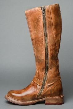 """Align your great style with this fashionable pair GLAYE. A truly versatile riding boot style that can be paired with a dress and lots of layers or your favorite pair of skinny jeans. Notable features include a back shaft zipper that expands for a more comfortable fit ankle strap with vintage buckle and red sole with treaded rubber plates.   Vintage leather equsestrian riding boot  Functional side zipper and partial back zipper   Partial Leather sole with rubber plates  Approximate 14""""…"""
