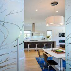"Futuro Futuro ""Streamline"" illuminated designer island range hood in a contemporary kitchen b y ARAN Cucine (Italy). Kitchen sold & installed by European Cabinets & Design Studios in Palo Alto. Photo Credit: Dennis Mayer."