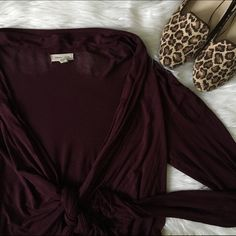 [silence + noise] maroon tie front cardigan super cute cardigan! slouchy look. ties in the front and fits loosely. very stretchy, cozy fabric with long sleeves that you can push up for a relaxed look. has unsewn seams (purposely). gorgeous maroon color. in good condition! silence + noise Sweaters Cardigans