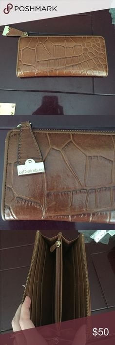 Antonio Melani croc wallet Brown faux croc wallet by Antonio Melani. In great shape! I got so many compliments when I used it! Got a new Kate spade for my birthday though so that's why I'm selling! ANTONIO MELANI Bags Wallets