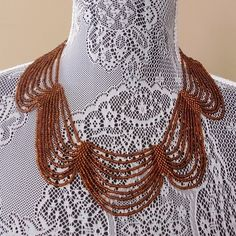 Beaded Collar Necklace in Ambery Brown Beautiful collar necklace with ambery brown beading. Great way to accentuate any neckline. Very lightly worn, excellent condition. Jewelry Necklaces