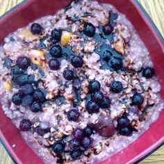 Cherry mango oatmeal with blueberries and molasses