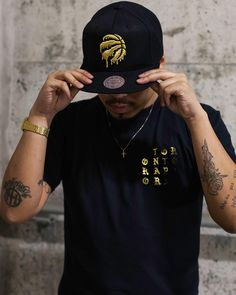Now available Mitchell and Ness Raptors Liquid Gold Snap and  NBA Church Gold Raptors Tee.