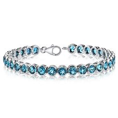 MSRP: $699.99   Our Price: $399.99   Savings: $300.00    Item Number: SB2754(2)   Availability: Usually Ships in 5 Business Days    PRODUCT DESCRIPTION:    Crafted in Sterling Silver, this beautiful bracelet features vibrant London Blue Topaz gemstones bezel set for a sleek and modern design. This beautiful bracelet makes the perfect gift for the December Birthday or any occasion.    FEATURES:    Crafted in Fine Sterling Silver   (32) 5.0 mm Oval Genuine London Blue Topaz Bezel Setting …