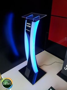 I like the sleekness of this display stand and it also has neon lighting to help guide the visually impaired who may still be able to see light. Tv Set Design, Kiosk Design, Pop Design, Stage Design, Retail Design, Pos Display, Display Design, Booth Design, Exhibition Stand Design