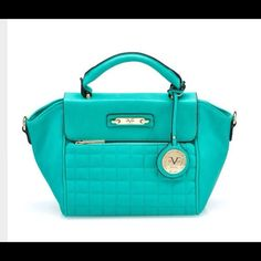 % AUTHENTIC VERSACE Satchel % AUTHENTIC VERSACE 1969 Abbigliamento Sportivo s.r.l.  This is a gorgeous Satchel by Versace the Sortivo line. Beautiful greenish teal color. Also comes with a shoulder strap. It's a top Color for 2016 Spring/summer!!! Please ask ALL questions before purchasing. No trades No offline transactions. Thanks for stopping by!!  Versace Bags Satchels
