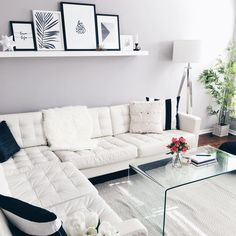 Scandinavian style simple living room with white couch and ikea wall shelf