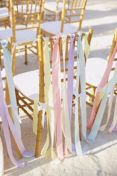 Pastel chair ribbons | Photography: Darling Juliet Photography - darlingjuliet.com  Read More: http://www.stylemepretty.com/little-black-book-blog/2014/04/24/diy-pastel-islamorada-wedding/