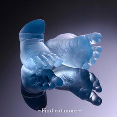 Baby Feet cast in blue glass by Wrightson and Platt UK
