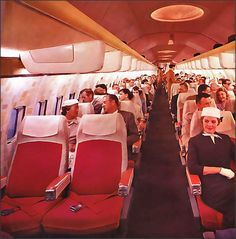 boeing 707, 1958 -there's actually a gap between the seats and the passengers are waiting for lunch!