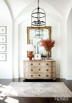 Such beautiful arched details in this foyer