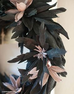 I designed this elegantly spooky wreath with textured black flowers and feathers for my DIY Halloween Decorations. So spooky yet just a bit lovely. Tutorial @LiaGriffith.com