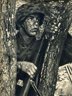 Waffen SS soldier taking cover.