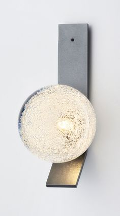 The Fizi Ball collection's glass balls are heavy, luxurious and bursting with an explosion of bubbles that, when lit, throw dramatic patterns and movement into the surrounding space and onto the walls.