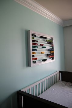 Make your own enormous abacus to hang on the wall- great for nursery