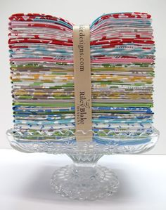 Fabric on a cake pedestal, great way to display all my vintage fabrics for sale at Park & Albaum.